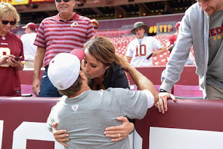 Kirk Cousins and his wife Julie Hampton kissing