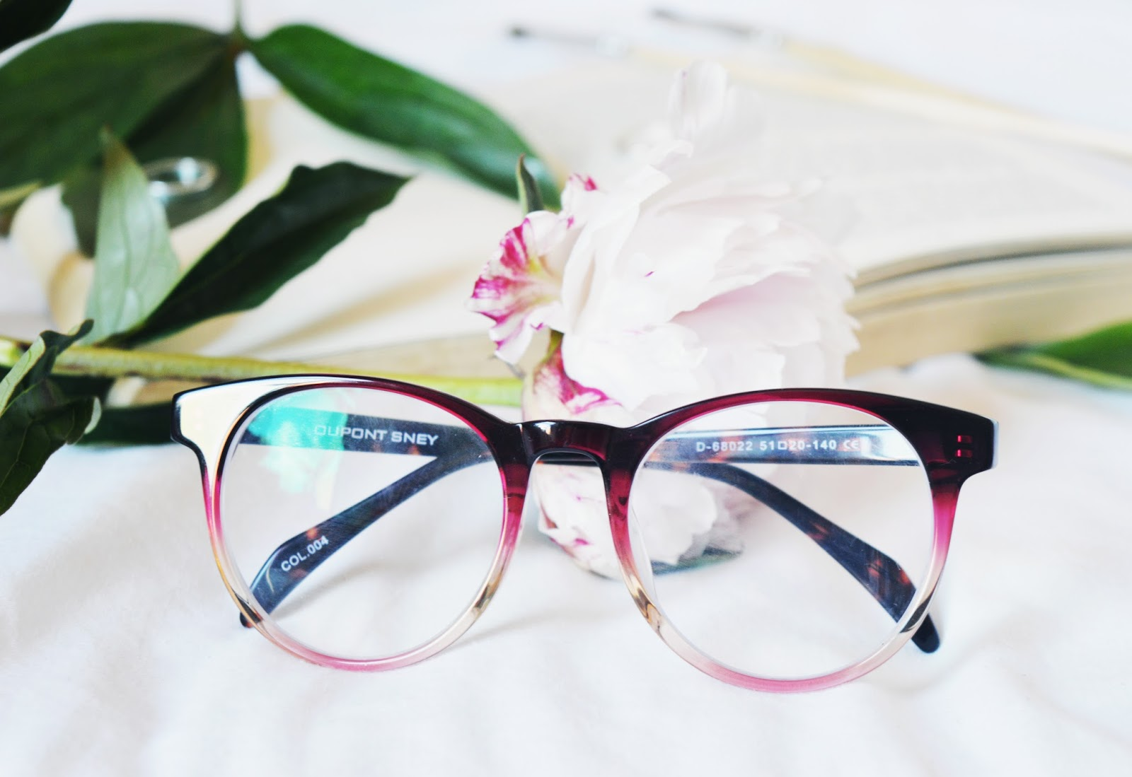 pink glasses front on