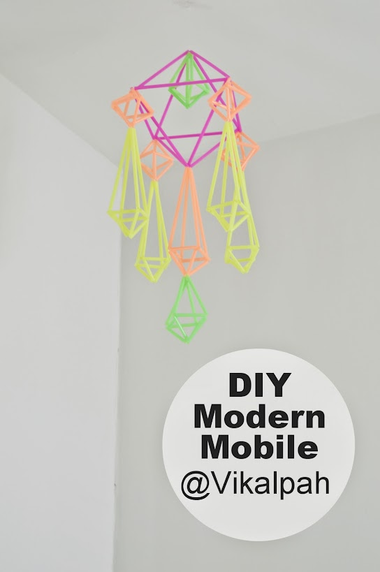A mobile made of straws hanging from the ceiling