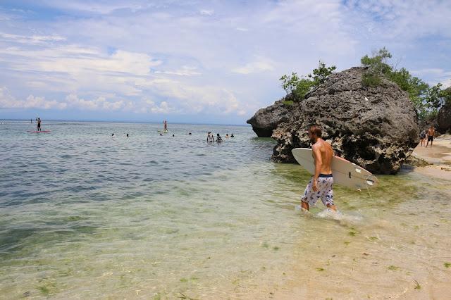 Surf Padang Padang Beach in Uluwatu in Bali