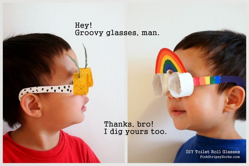 boy wearing toilet roll glasses