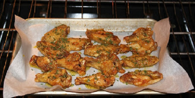 These are baked wings on parchment paper coated in lemon garlic and there are four other flavors Marsala, parmesan, butter flavored, herb flavored wings