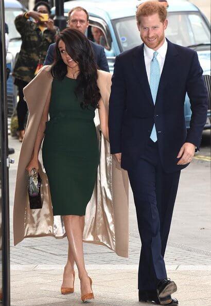 Meghan Markle carried Montunas mini guaria bag, She wore Sentaler wap coat, P.A.R.O.S.H. bow detail sleeveless dress