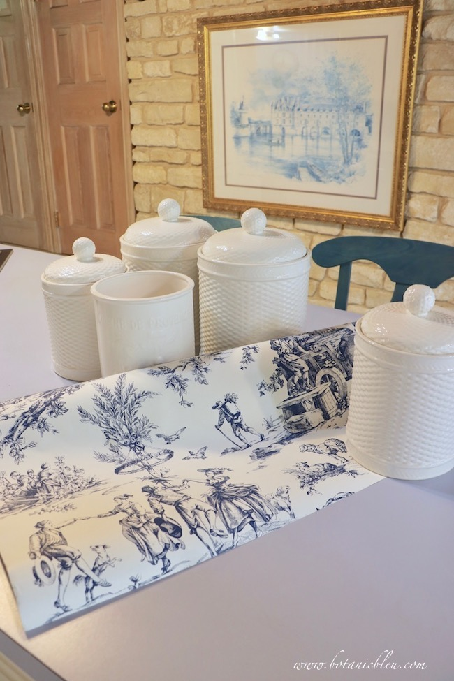 Pantry makeover plans for adding French Country toile wallpaper and white canisters