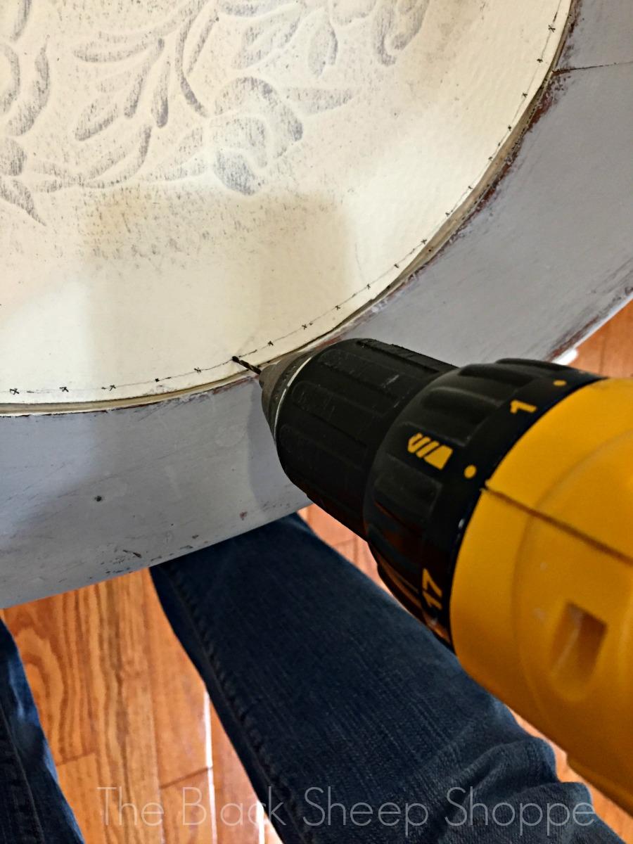 Pre-drilling holes into fiberboard seat