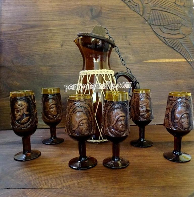 Hand Blown Amber Glass, Matching set of Six Wine stemmed Glasses, Carafe with Lid. Faux Leather collar depicting Conquistadores