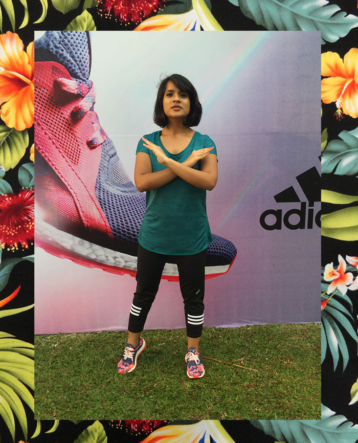 Dayle Pereira, the fashion blogger at Style File showcases her personal style in an adidas tshirt, adidas leggings and adidas pure boost X floral print sneakers