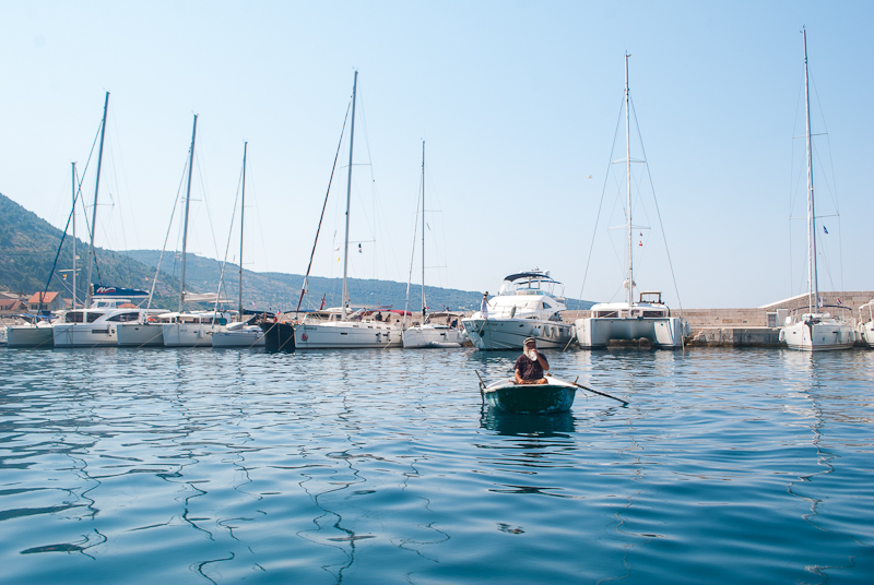 Vis Island port image with old fisherman in it - croatia