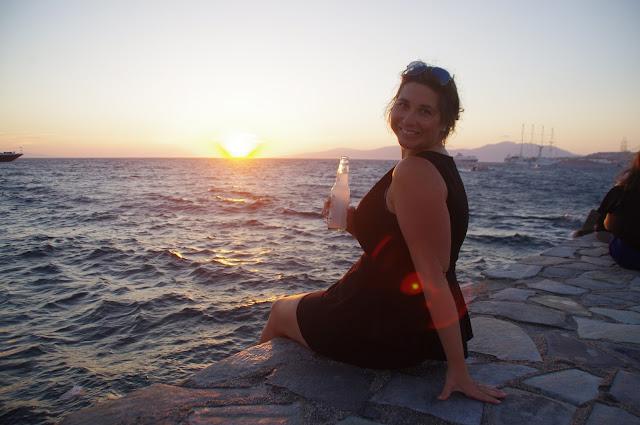 Girl having sunset drinks at Mykonos Islands