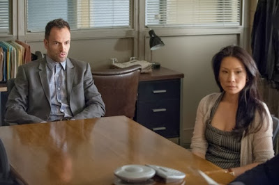 Jonny Lee Miller as Sherlock Holmes and Lucy Liu as Joan Watson in CBS Elementary Season 2 Episode 9 On the Line