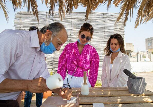 Queen Rania wore a new printed-satin pink blouse by Off-White. Princess Iman wore superstar training shoes running white sneakers by Adidas