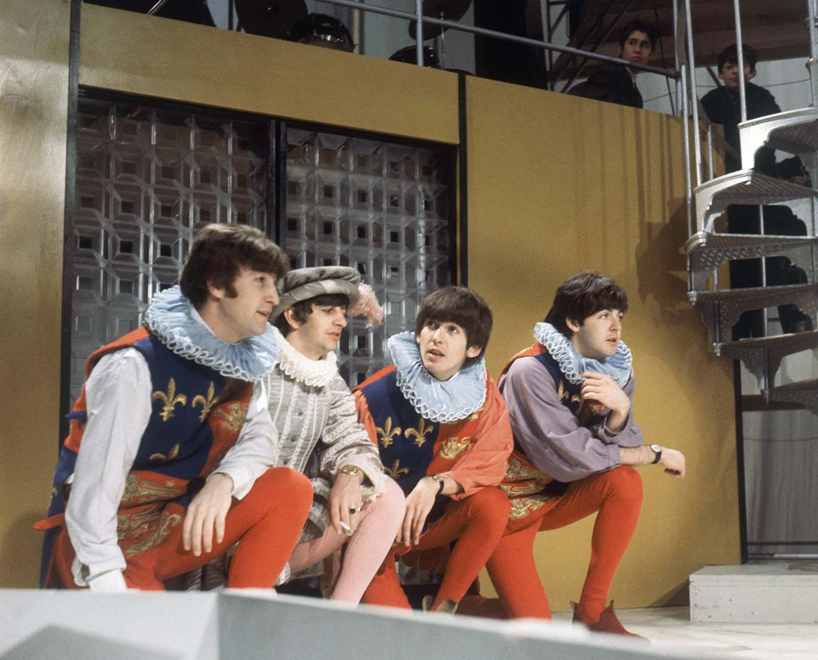 The Beatles rehearse for their forthcoming television show at Wembley studios in London, in April of 1964. In this skit, Ringo Starr, second from left, is costumed as Sir Francis Drake, and the others, from left, John Lennon, George Harrison and Paul McCartney play Heralds.