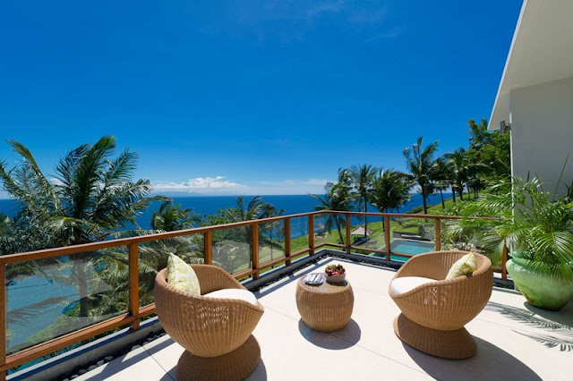 Picture of two brown chairs on the cliff villa terrace overlooking the ocean