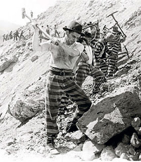 prisoners smashing rocks