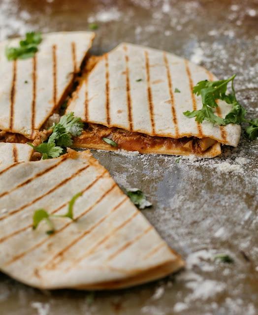 Cheesy chicken quesadillas with coriander.
