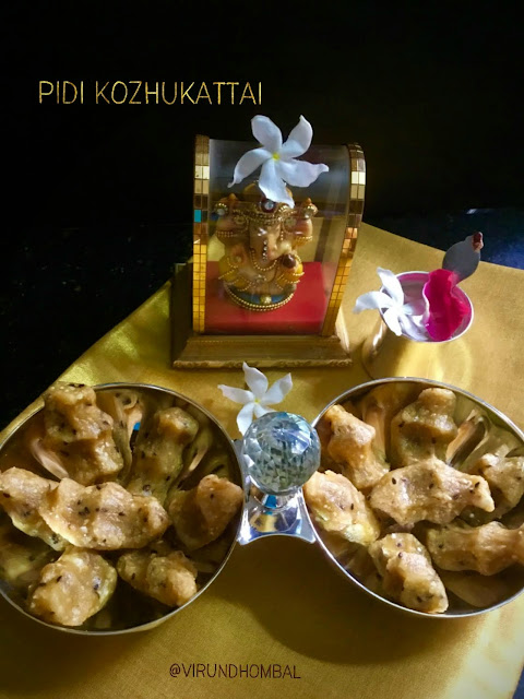 Sweet Pidi Kozhukattai | Rice Dumplings with Jaggery - Sweet Pidi Kozhukkatai - a classic prasadam recipe for pooja made with raw rice, jaggery, coconut, moong dal and black sesame seeds. This Pidi Kozhukkatai is a popular kozhukattai dish with different variations, although the most common method is prepared with the freshly prepared homemade rice flour as we do for maa vilakku. As I said in my previous posts, the coconut adds a great flavour to the jaggery based desserts.