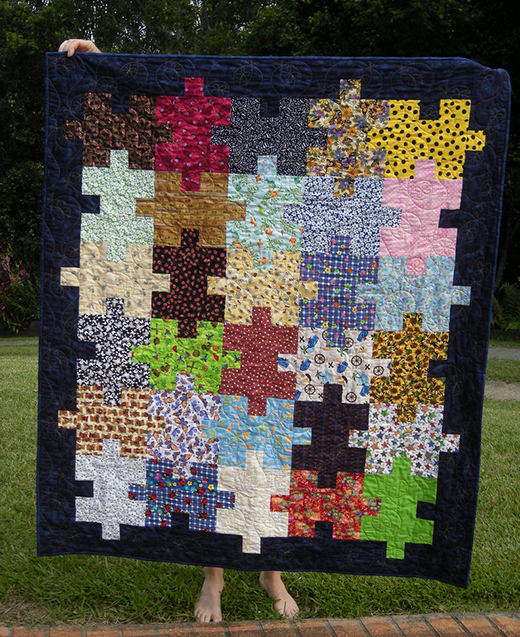 Easy Jigsaw Puzzle Quilt Designed by Janet Wickell of The Spruce Crafts