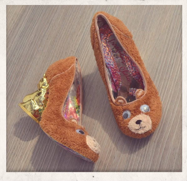 brown fur bear shoes one with googly eyes face, one on it's side showing hold character heel