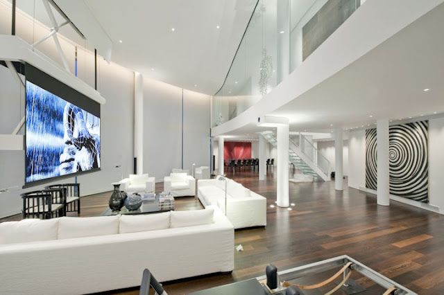 Picture of the London penthouse living room during the movie time with the white curtains on the large windows
