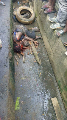 Graphic photos: Suspected female kidnapper burnt to death in Ikorodu