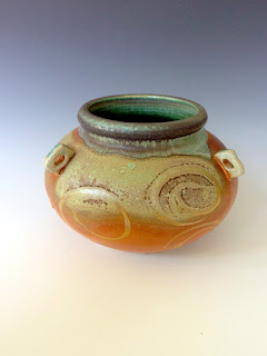 Soda fired ceramic vessel by Lori Buff