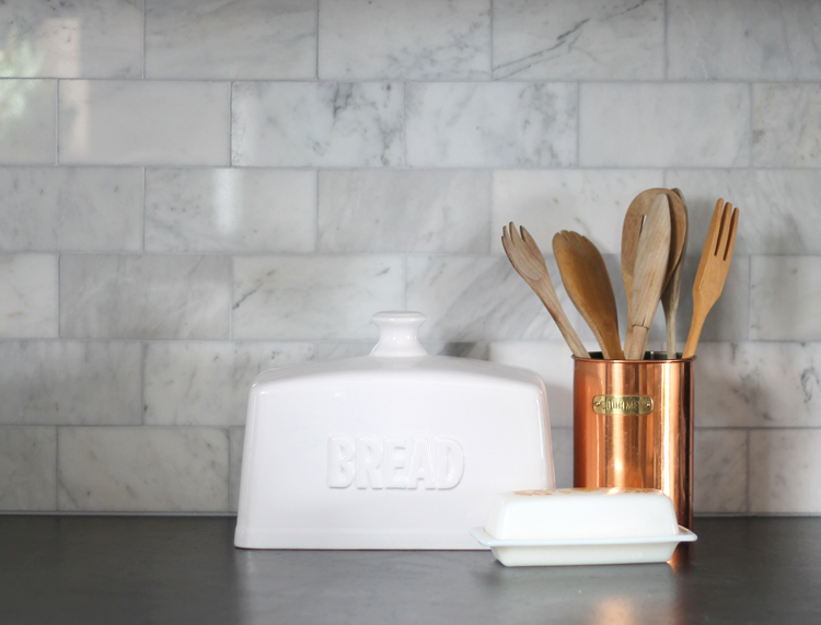 Marble subway tile is the perfect updated traditional kitchen backsplash