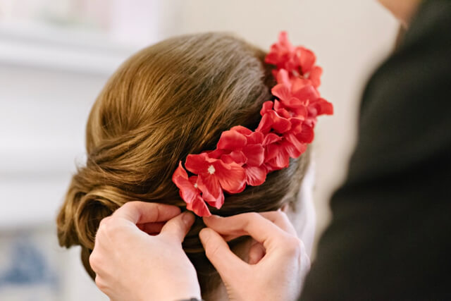 Red starlet flower hair comb for 50s style wedding hair