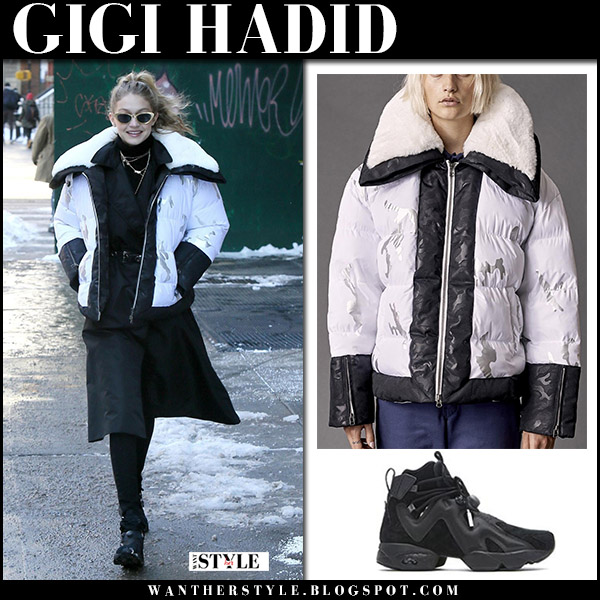 Gigi Hadid in white and black puffer jacket biannual and black sneakers reebok street style january 5 2018