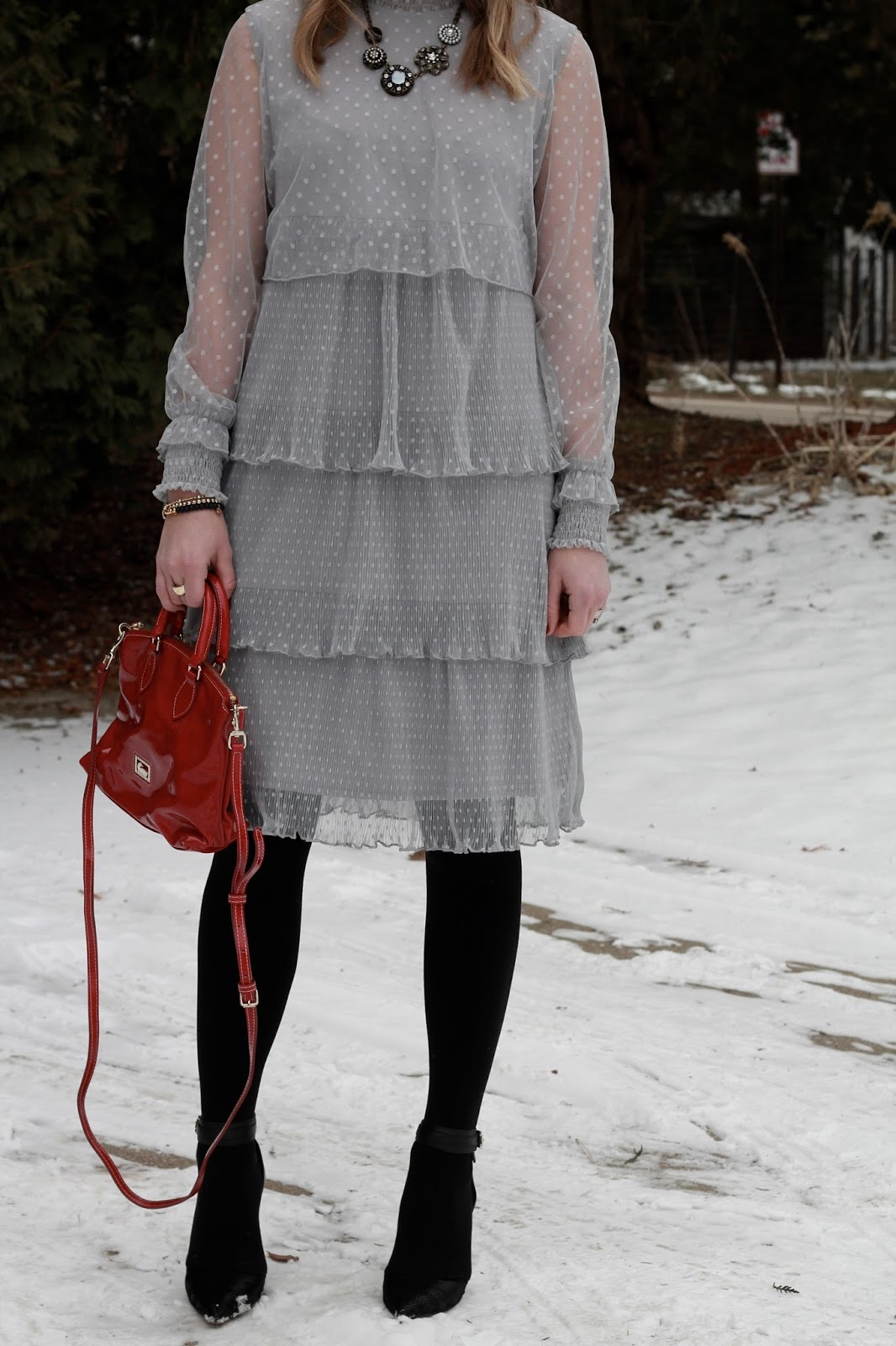 layered grey lace dress, red Dooney & Bourke bag, black ankle strap heels, vintage statement necklace