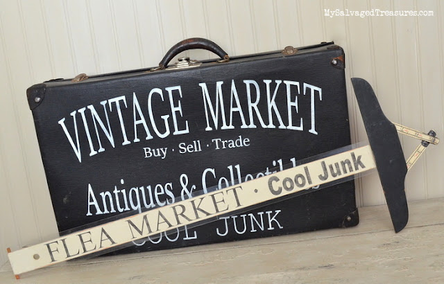 repurposed vintage suitcase and folding ruler signs