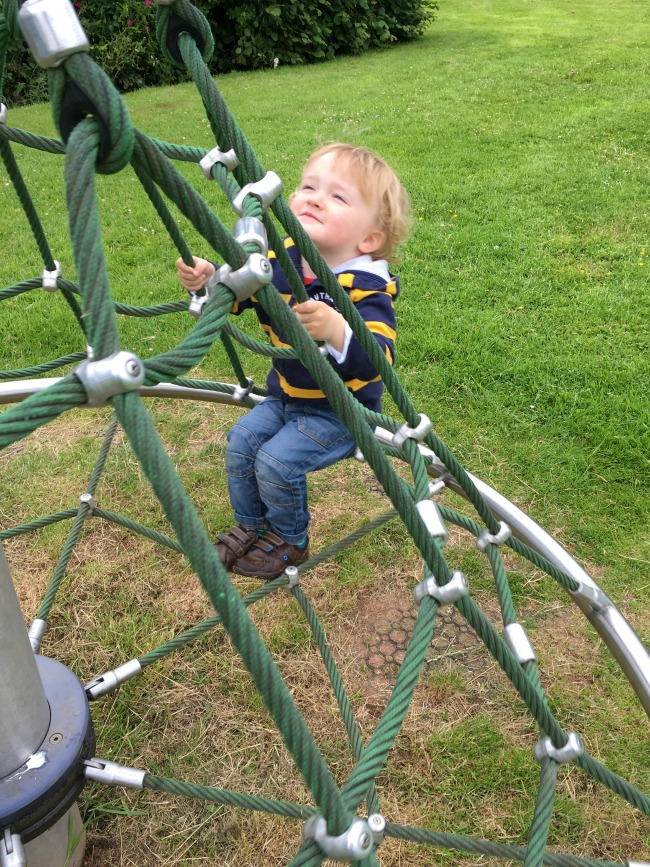 our-week-of-plays-toddler-sat-on-climbing-frame
