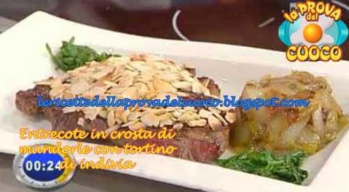Entrecote in crosta di mandorle con tortino di indivia for Cucinare entrecote