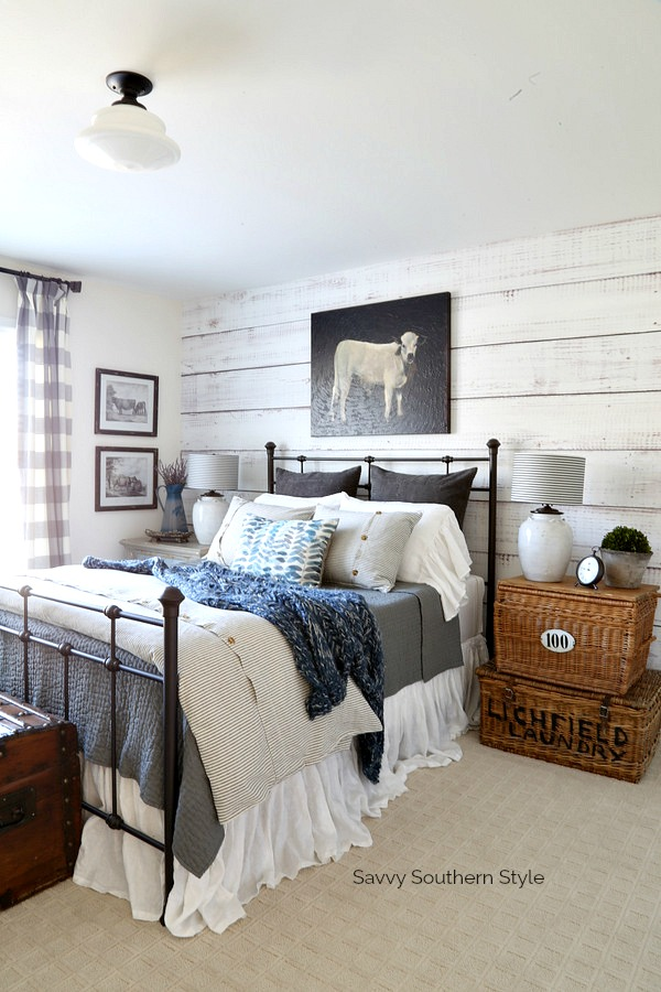 farmhouse style guest bedroom with iron bed