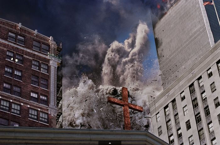 18 Rare Historical 9/11 Photos That You Most Possibly Haven't Seen Before - The South Tower Disintegrates, Raining Debris Behind A Cross Atop Trinity Church