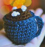 http://www.ravelry.com/patterns/library/hot-cocoa-mug-ornament