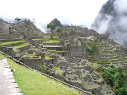 Machu Picchu central sector with temples, unrestored areas, watercourse, stairs