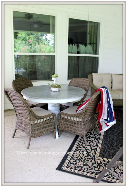 covered back porch-wicker dining chairs-round pedestal dining table-  from my front porch to yours