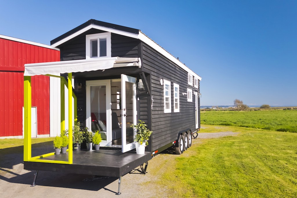 Tiny house town custom home from the mint tiny house company for Small livable cabins