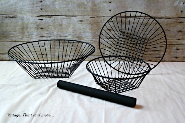 three wire baskets spray painted used to diy a standing wire basket
