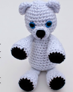 http://stitchandunwind.com/free-crochet-pattern-klondike-the-snow-bear/