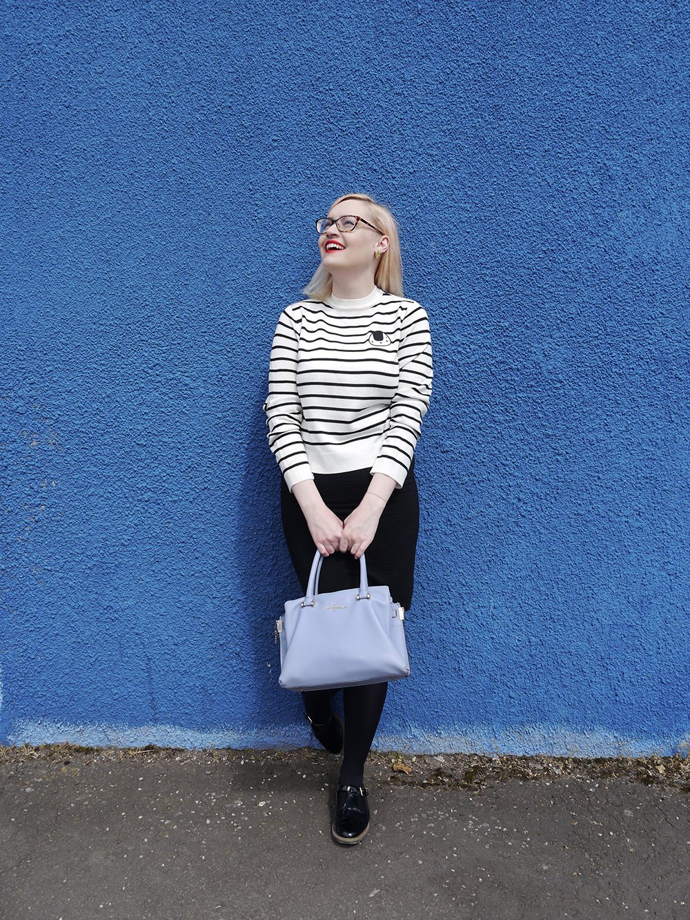 Scottish fashion blogger, Wardrobe Conversations, Jasper Conran bag from Debenhams, blue background, monochrome outfit inspiration, The Whitepepper top, sushi print, Dundee fashion shoot location, Dundee style blogger