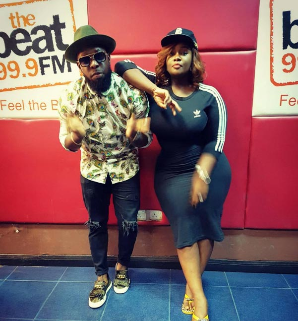 OAP Toolz poses with singer Timaya