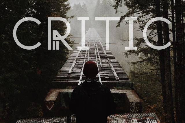 A woman crossing a bridge with the word critic written on it.
