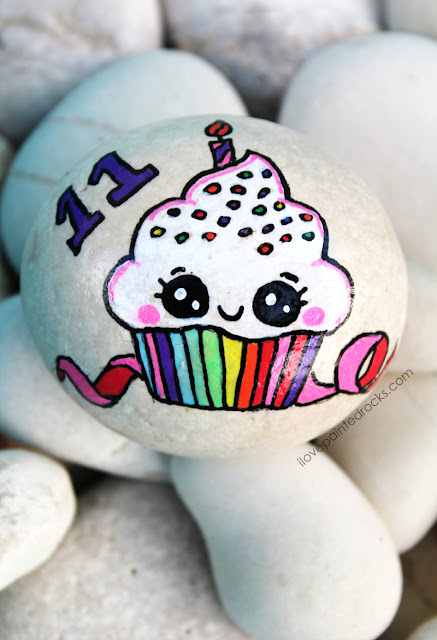 ideas for painting rocks - a rainbow birthday cupcake with sprinkles and a ribbon