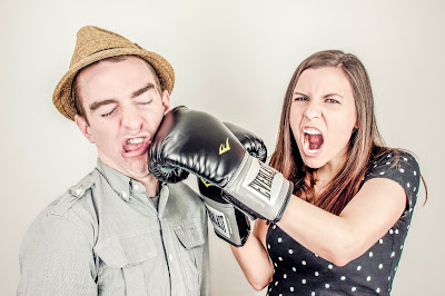 Girl punches man - she's a teacher.
