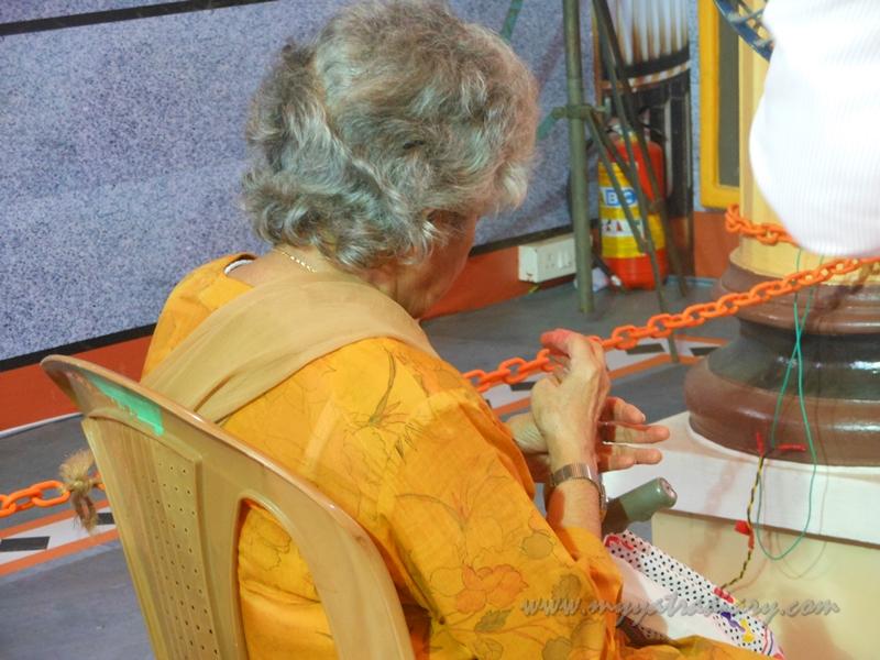 A woman chanting at Andhericha Raja life size Ganesha pandal, Mumbai