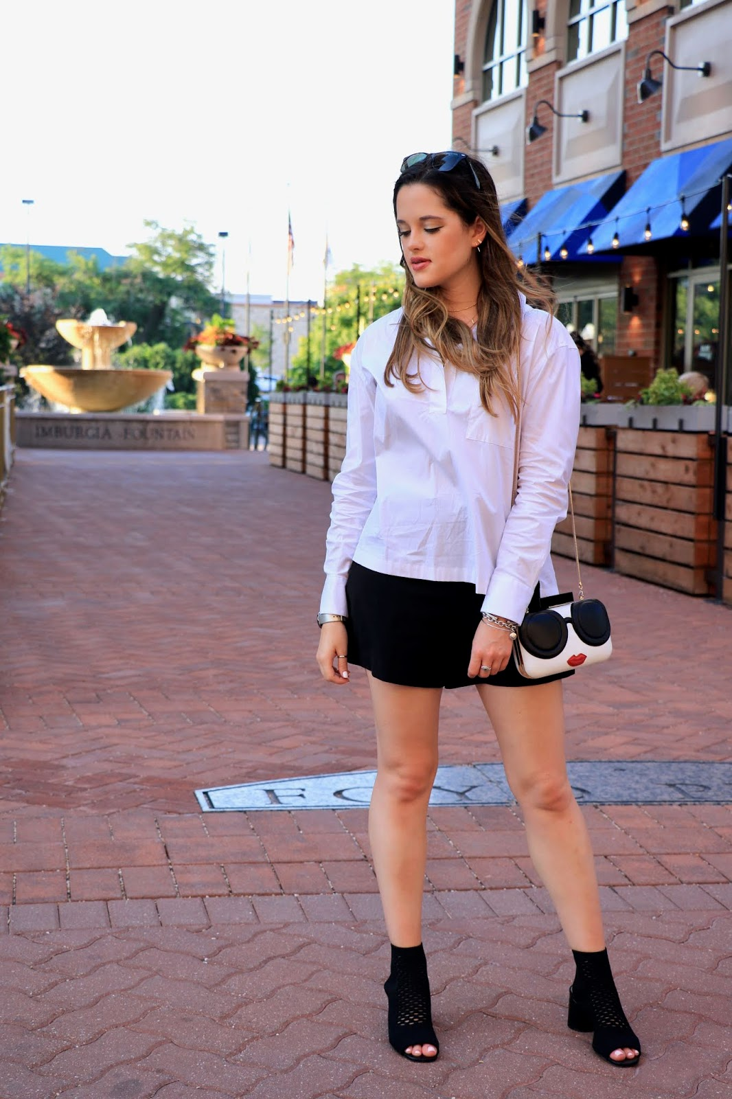 Nyc fashion blogger Kathleen Harper showing how to wear shorts to work