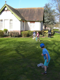 playing cricket in the park by the bowling club