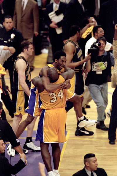Kobe Bryant and Shaquille O'Neal celebrate after the Los Angeles Lakers defeated the Indiana Pacers, 116-111, in Game 6 of the NBA Finals at STAPLES Center...on June 19, 2000.