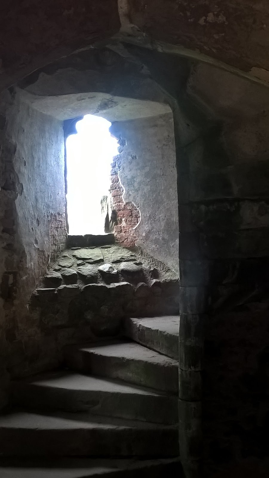 light flooding through a turret window at Raglan Castle